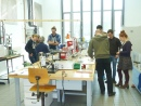 Two groups of short course participants in the piston cylinder lab